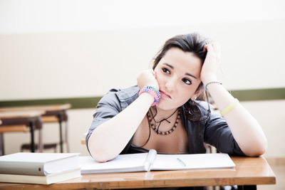 Teenage girl in school struggling to focus and is getting frustrated